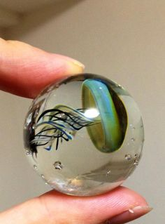 """Spectacular """"Space Glass"""" Pendants Let You Hold the Cosmos in the Palm of Your Hand, by  Japanese glass artist Satoshi Tomizu"""