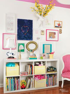 An awkward nook of space gets a storage redo with a few simple tweaks. A basic cube organizer doubles as bookshelf and toy box, while the top shelf holds treasured collectibles. A cozy chair encourages your kiddo to curl up with a book. Decor, Pink Living Room, Dining Room Walls, Home, Spring Decor, Small Floor Plans, Space Makeover, Low Bookcase, Small Space Diy