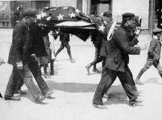 An American victim of the sinking of the Lusitania being carried away, from 'The Illustrated War News' (b/w photo). 128 Americans died on the Lusitania.