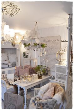 Beautiful white, shabby small living space.  A bit much but still very very pretty and cozy.