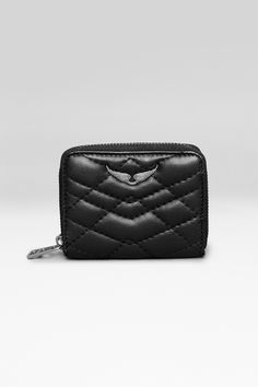 Zadig et Voltaire quilted zipped wallet, with a metallic rivet wings on the front, inside compartments, depth 2cm, height 8,5cm, length 11cm, 100% leather, twill cotton lining.