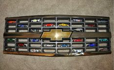 Check out this cool way to display your Hot Wheels cars using the grill from a Chevy.