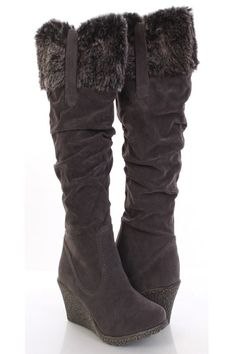 This is a very sexy shoes that is sure to get attention! Rock it out at your next glamorous event! You definitely cant go wrong with these stylish pair. Very adorable boots that features: Faux fur trim, faux suede, side zipper closure, and finished with texture wedge. Approx 3 inch wedge, 19 inch shaft, and 15 1/2 inch circumference.