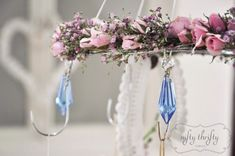 Nifty Thrifty Things DIY for a Spring Chandelier made out of white wire hangers - how fun!