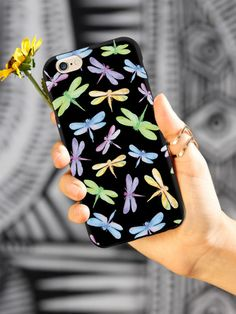 Give your iPhone 6 & 6s cell phone a unique style all its own. This Watercolor Dragonflies Pattern - Black Case was professionally created and printed in the United States for anyone who likes dragonflies! Textured printing raises parts of the images, creating a unique feel like no other case.  The case features high-quality, original design and images that not only set you apart, but keep your device protected - making it the perfect iPhone 6 & 6s accessory!
