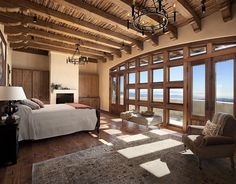 Master bedroom with handcrafted exposed wood beams and that view! Love it. Check out the whole house!