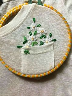 Embroidery Stitches 50 Easy DIY Embroidery Shirt Designs You Can Do By Hand - The Thrifty Kiwi - A closet staple that's currently trending is embroidered apparel. Albeit charming, the quirky embroidery designs you adore are not at the… Diy Embroidery Shirt, Hand Embroidery Stitches, Embroidery Art, Cross Stitch Embroidery, Embroidered Shirts, Diy Clothes Embroidery, Embroidered Flowers, Embroidery Hoops, Diy Embroidery Flowers