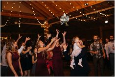 Bouquet toss, Indoor wedding reception, Wedding reception details, Burgundy wedding decor, Floral wedding centerpieces, Wedding reception inspiration, Family style tables, String lights at wedding, Boho indoor wedding, Planet Bluegrass Wedding, Lyons Colorado Wedding, Lace and Lillies, Colorado Wedding Photographer, A Spice of Life, Boho Wedding Inspiration, Burgundy wedd