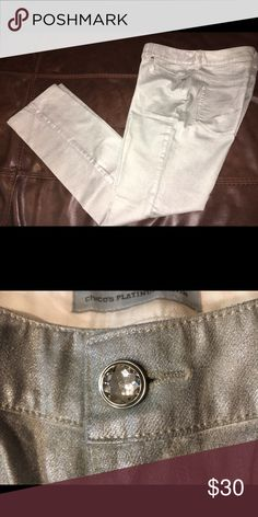 Chico's Platinum Denim Metallic Silver NWOT Never been worn. Size 0.5. These have been professionally hemmed to fit a height of 5'5. They are a shiny metallic silver. Chico's Jeans Straight Leg