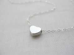 Simple tiny silver heart necklace - little silver heart - silver necklace. $26.00, via Etsy.