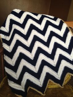 Easy to work up, and adorable baby afghan. Perfect for a gift to keep a new baby nice and warm. This blanket would be adorable in any color, and you could add fringe to make it more lively.