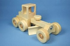 You are looking at a high quality, carefully handcrafted wooden toy Road Grader. Each truck is constructed individually in my shop, rather