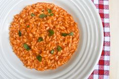 Tomato risotto is a simple and tasty Italian dish. Italian Spoon's recipe for Tomato risotto combines the sweet taste of tomatoes with the freshness and aroma of chopped basil. It is loved by all ages and guaranteed to be your next family favourite. Try it today! Italian Pasta Recipes, Best Italian Recipes, Italian Dishes, Tomato Risotto, Italian Tomato Sauce, Pasta Sides, Food Mills, Lunch Recipes, Spoon
