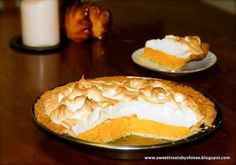 Orange Meringue Pie- Flaky buttery pie crust filled with sweet orange curd and topped with fluffy tall meringue. So irresistible!