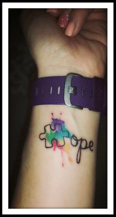 Autism awareness puzzle piece watercolor tattoo for my son :-)