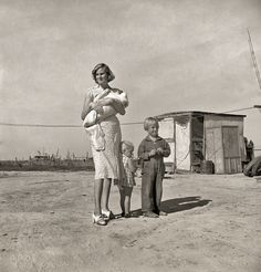 "A Growing Family: 1938- ""Family of rural rehabilitation client (last seen here). Tulare County, Calif. Husband also works about ten days a month outside the farm, is 26 years old, wife 22, three small children. Been in California five years."" Photo by Dorothea Lange"