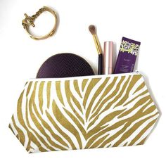 Party like an animal with this Metallic Zebra Print Cosmetic Bag. . . . #colorful #brightcolors #instalike #instamood #instatraveling #instadaily #onlineshopping #shop #shopping #shoppingonline #shoplocal #bag #cosmetic #zebra #animal #animalprint #etsy #