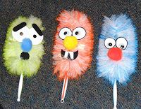 Rhyming Dust Bunnies Puppets & more creative story ideasThe mops, once you add some facial features, are Ned, Ted, and Bob (we dropped Ed to make the puppetry more manageable).  The eyes and and mouths are laminated paper, stuck on with hot glue; mouths are big pom pons.  The bright colors are really appealing, and stick puppets work great for the story, where the characters' movements are simple and distinct:  appear, disappear, side to side, etc.