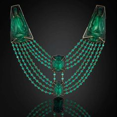 The Beetle necklace... by Rene Lalique c.1905, a salute to Egypt in gold, enamel and moulded glass with two larger green glass beetles backed with silver foil and mounted on yellow gold and two further moulded glass beetles held with black enamel claws.  via The Jewelry Gig & The Jewellery Editor