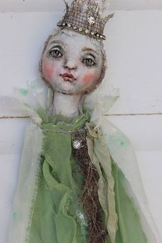 ....vidalia onion princess.... is an original, one of a kind art doll created by me.....karen milstein (k d milstein) she is made of misc fabrics, i use linen for the hand painted face....then i add a variety of fibers, flowers, rhinestones, silver thread, german silver glass glitter, lace, ribbons, metal and more (mostly vintage)..... this is a wall doll, will come signed dated and branded with my ranch brand...comes ready to hang . vidalia measures 22 tall......    to see more pics of my…