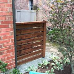 Cedar a/c cover on metal posts. Installed by Titan Fence & Supply Company. Cedar a/c cover on metal Fence Slats, Diy Fence, Cedar Fence, Wooden Fence, Fence Ideas, Fencing, Small Fence, Horizontal Fence, Trash Can Covers