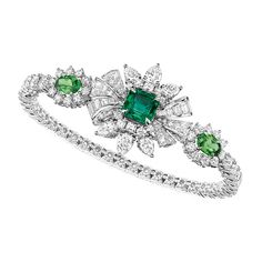 White gold Plumetis Émeraude bracelet with diamonds, emeralds and tsavorite garnets from the new Soie Dior high jewellery collection.