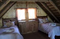 Accommodation and reservations at Platbos Log Cabins, in Rawsonville Enjoy The Silence, Higher Ground, Holiday Accommodation, Open Plan Kitchen, Queen Size Bedding, Two Bedroom, Living Area, Loft, Cabin