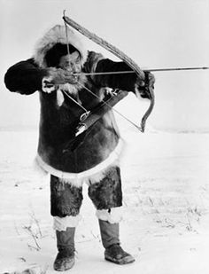 Traditional Inuit hunting was carried out much like that of the Native American tribes.  This Inuit native is hunting with a bow and arrow, and we can only guess that he is aiming at a seal or walrus that's made its way to the surface.