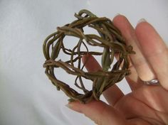 Continue to build up the ball shape by placing the wreaths over the first two willow wreaths