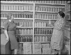 food storage room - love the paper scallops on the shelf edges!!  It's the woman's touch!