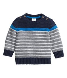 Free Pattern! Knitted Baby Sweater in Rico Baby Classic DK ... 2b907b9ac