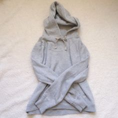"""Grey draw string hoodie Amazing condition grey sweatshirt! Only worn a few times. Back of garment says """"The Sky's The Limit"""" and the hood has purple birds. Very soft on the inside. NOT Free People! Size medium. Smoke and pet free home. Happy Poshing!  Free People Tops Sweatshirts & Hoodies"""