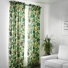 Refresh your home with these leaf print curtains that add a pop of color to a monochromatic decor.