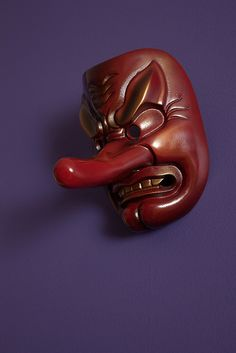 A Tengu Mask. Buddhism long held that the tengu were disruptive demons and harbingers of war. Their image slowly changed over time into one of protective, yet still dangerous, spirits of the mountains and forests.