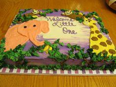 jungle themed baby shower cake with elephant, giraffe, & monkeys (btw I love the bananas)