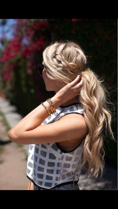Loose ditch braid into ponytail with waves