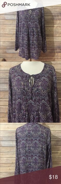 J. Jill Purple Paisley Tunic Sz XS This is a beautiful purple paisley Tunic top from J Jill. Long sleeves, has pin tucks down the front, and it has black and cream in it as well. 100% rayon, so there's no stretch. Laying flat from under arm to under arm the bust measures 18 inches and overall length is 26 1/2 inches.  Like new condition. T183. Loc A10 J. Jill Tops Tunics