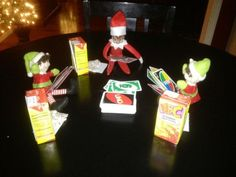 Elf on A shelf playing UNO with a couple other friends (could be ours) and Hi C juice boxes (could be our drinks/snacks)