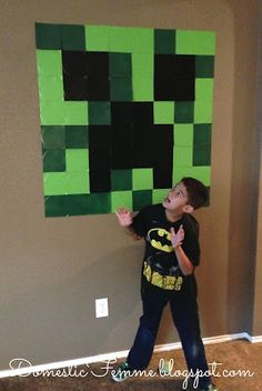 Minecraft Birthday Party Creeper Wall Display #Parties #Birthdays #DIY #Character #Characters #Supplies #Idea #Ideas #TNT #Twizzlers #Torches #Chocolate #Dipped #Pretzel #Pretzels #Rods #Rods #Dirt #Brownie #Brownies #Coal #Rice #Krispies #Treats #Krispie #Crispie #Crispies #Zombie #Zombies #Boogers #Booger #Popcorn #Corn #Candy #Stickers #Enderman #Steve #Creeper #Printables #Printable #Cake #Instruction #Instructions #Instuctable #Instructables #Tutorials #Ghost #Face #Paper #Plate #Plates