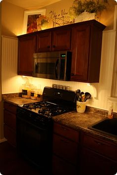 Accent lighting using rope lights- i would want them to be LED forsure, extra life and wont get hot. Perfect way to brighten our kitchen!