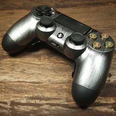 controller with custom steel shell, bullet buttons and Shock paddles Control Playstation, Consoles, Bullet Button, Nintendo, Gamer Room, Xbox One Controller, Gaming Setup, Videogames, Esports