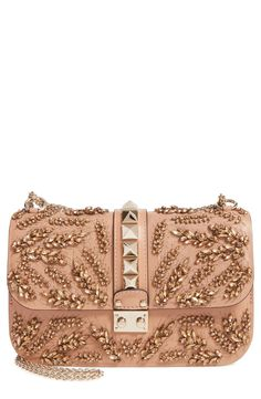 Stunning detail and pyramid studs makes this crossbody standout and sparkle.