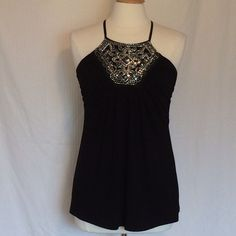 HP!NWT WHBM black beaded cross back halter top Love this top! Very cute and comfy with a built in shelf bra. Soft ruching on bust. Body is A line  with a swingy drape. Brand new! Size small. Smoke free home. White House Black Market Tops