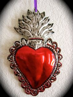 "Colorful SACRED HEART Mexican Tin Ornament- Perfect for the one you love- 7.5"". $12.75, via Etsy."