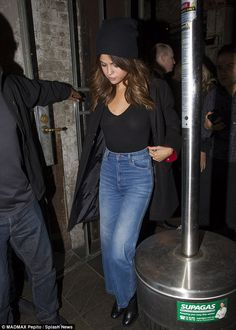 Carefree: Daring to bare in her see-through top, the brunette beauty appeared carefree as she left a Chinese restaurant in the city's CBD