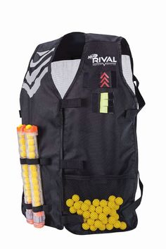 Head into battle with the NERF Rival Tactical Vest featuring magazine storage compartments and a mesh storage pocket. Carry over 150+ rounds! Complete with Velcro life indicator flags and interchangeable Velcro team colors, the NERF Rival Tactical Vest is sure to heat up the competition!Holds over (150+) roundsLarge mesh pockets for round storageHolds (8) Magazine clips total: (4) on front & (4) on back for easy access Nerf Tactical Vest, Nerf Vest, Arma Nerf, Magazine Storage, Police Officer Gifts, Nerf War, Toys R Us Canada, Gun Holster, Gifts For Kids