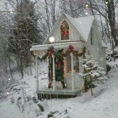 I think this is the same cozy white cottage in the Winter. Beautiful!