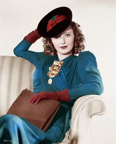 Barbara Stanwyck, 1940s. Blue suit, gloves, hat and clutch bag.