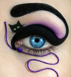 Check out this amazing cat make up by Tal Peleg, make up artist and designer from Israel! Tal turns her model's eyebrow into a cat's tail, and the body is painted on the upper eye lid. To make it more playful, the artist even attached a little thread ball under the bottom eye lid, with a purple thread going down the cheek.