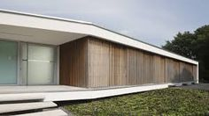 This villa for a married couple with child is built on the original location of a dated bungalow from the in Haelen, The Netherlands. The villa, designed by architect Loek Stijnen from architects, meets th. Facade Design, Architecture Design, Minimalist Architecture, Villas, Rendered Houses, Interior Exterior, Interior Design, Modern Family, Modern Minimalist